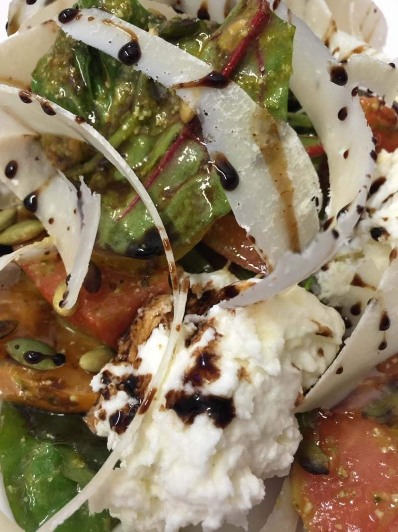 Heirloom tomato salad, buffalo mozzarella, parmesan, pesto, chilli, balsamic, pumpkin seeds